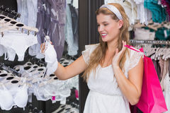 Pretty woman buying sexy lingerie Stock Image