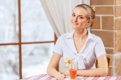 Pretty woman in cafe Royalty Free Stock Photos