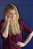 Pretty Woman Calling Someone Through Mobile Phone While Smiling Royalty Free Stock Image