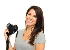 Pretty woman with camera Stock Photography