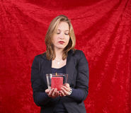 Pretty woman with candle in red royalty free stock photos