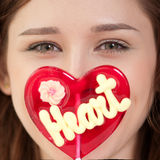 Pretty woman with candy heart Royalty Free Stock Image