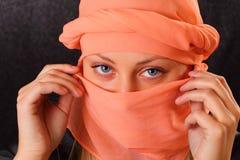 Pretty woman in cape Stock Photography