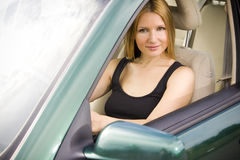 Pretty woman in the car Stock Photography