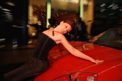 Pretty woman with the car. Stock Image
