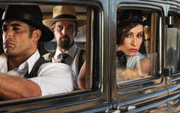 Pretty Woman in Car with Gangsters. Beautiful 1920s era women with mob gang in car Stock Photos