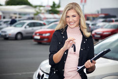 Pretty woman with car keys and car Stock Photo