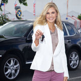 Pretty woman with car keys and car Royalty Free Stock Images