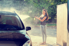 Pretty woman in the car wash - hand wash Stock Photos