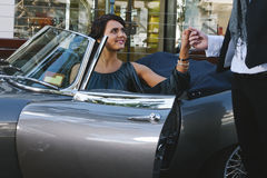 Pretty woman in car Stock Images