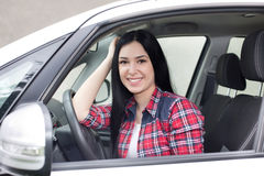 Pretty woman in the car Royalty Free Stock Image