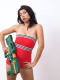 Pretty woman carries toy gun Royalty Free Stock Images