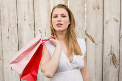 Pretty woman carrying shopping bags over her shoulder Stock Photography