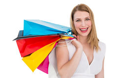 Pretty woman carrying shopping bags over her shoulder Royalty Free Stock Photo