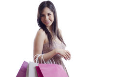 Pretty woman carrying shopping bags Royalty Free Stock Photography