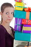 Pretty woman carrying a stack of gifts Royalty Free Stock Photos