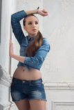Pretty woman with casual style on the old wall Stock Photos