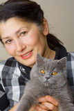 Pretty woman with a cat Royalty Free Stock Image