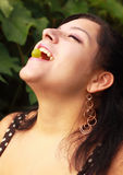 Pretty Woman Catching a Grape in Her Mouth Stock Photos