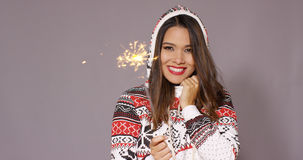 Pretty woman celebrating Christmas with fireworks Stock Photography