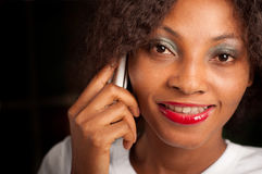 Pretty woman on cell phone. African American woman talking to the phone royalty free stock photo