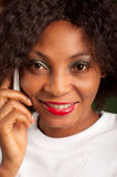 Pretty woman on cell phone. African American woman talking to the phone royalty free stock photos