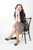 Pretty woman on chair Stock Images