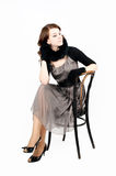 Pretty woman on chair Royalty Free Stock Photo