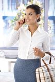 Pretty woman chatting on mobile smiling Stock Image
