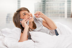Pretty woman chatting on mobile smiling Royalty Free Stock Photos