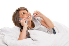 Pretty woman chatting on mobile smiling Stock Images