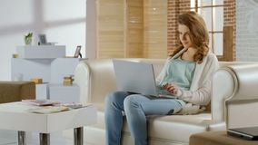 Pretty woman chatting in social networks on laptop, having rest, shopping online stock images