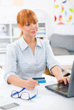 Pretty woman checking her bank account on internet from home Royalty Free Stock Photos