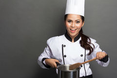 Pretty  woman Chef in action Stock Photography