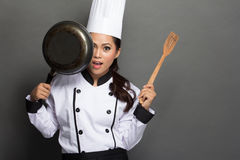 Pretty woman Chef have fun with her cooking tool stock images