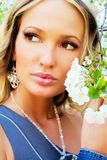 Pretty woman with a cherry tree flowers Royalty Free Stock Photo