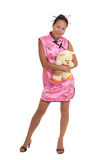 Pretty woman in chinese dress hugging bear Royalty Free Stock Photo