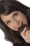Pretty  woman and chocolate. Pretty young woman eating a chocolate Royalty Free Stock Photo