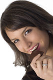 Pretty  woman  and chocolate. Pretty young woman eating a chocolate Stock Photography