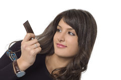 Pretty  woman and chocolate. Pretty young woman eating a chocolate Royalty Free Stock Photography