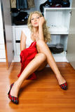 Pretty woman choosing what to put on Royalty Free Stock Image
