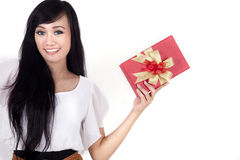 Pretty woman with a christmas box. Pretty Asian woman with christmas present isolated on white Stock Images