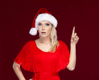 Pretty woman in Christmas cap Royalty Free Stock Images