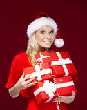 Pretty woman in Christmas cap Royalty Free Stock Photography