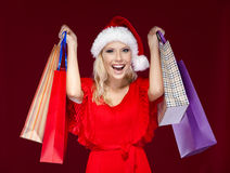 Pretty woman in Christmas cap hands packets Stock Photos