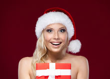 Pretty woman in Christmas cap hands present Stock Photo