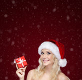 Pretty woman in Christmas cap hands present Royalty Free Stock Photos