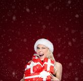 Pretty woman in Christmas cap holds a set of presents Royalty Free Stock Photo