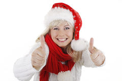 Pretty woman in christmas costume with thumbs up. Pretty smiling woman in santa costume thumbs up royalty free stock photography