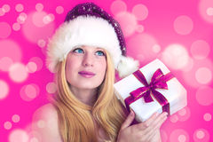 Pretty woman with christmas gift Royalty Free Stock Photo